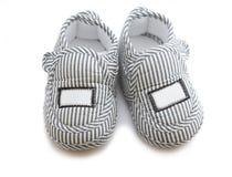 Chaussures de chéri d'isolement Photographie stock libre de droits