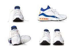 Chaussures de chaussures de course, bleues et blanches de sports d'isolement sur le dos de blanc Images stock