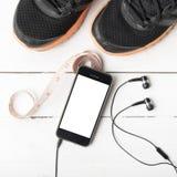 Chaussures de course, bande de mesure et téléphone Image libre de droits