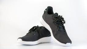 Chaussures de course d'espadrilles noires Photographie stock libre de droits