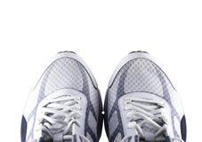 Chaussures de course d'isolement sur le fond blanc Image stock