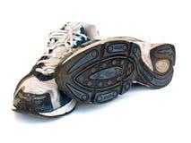 Chaussures de course de sport d'isolement sur le fond blanc Photographie stock libre de droits
