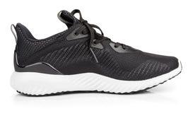 Chaussures de course, espadrilles ou entraîneurs d'isolement sur le blanc Images libres de droits