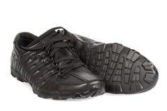 Chaussures de course noires Images stock