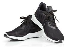 Chaussures de course ou espadrilles de sport d'isolement sur le blanc Photographie stock