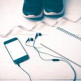 Chaussures de course, style de mesure de vintage de bande, de carnet et de téléphone Images libres de droits