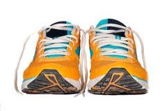 Chaussures de course utilisées oranges Photo libre de droits