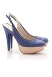 Chaussures de femmes sur le blanc Photo libre de droits