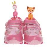 Chaussures de fille de sport d'isolement sur le blanc Images libres de droits