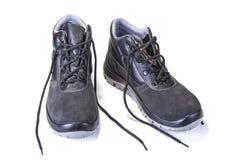 Chaussures de fonctionnement avec la plaque d'acier pour protéger des orteils sur le blanc photo libre de droits