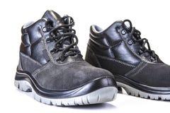 Chaussures de fonctionnement avec la plaque d'acier pour protéger des orteils sur le blanc photo stock