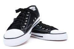 Chaussures de gymnastique d'isolement sur un fond blanc Image stock