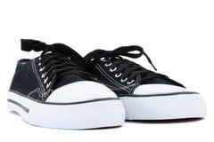 Chaussures de gymnastique d'isolement sur un fond blanc Image libre de droits