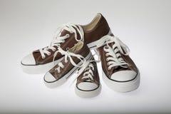Chaussures de père et de fils sur le blanc Photos stock