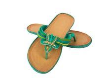 Chaussures de pantoufles de plage de femmes d'isolement sur le blanc Photo libre de droits