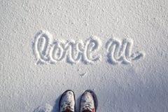 Chaussures de personne avec amour vous saison d'hiver Photo libre de droits
