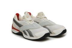 Chaussures de sport d'isolement sur le fond blanc Image libre de droits