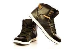 Chaussures de sport d'isolement sur les accessoires blancs de fond Images libres de droits