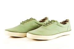 Chaussures de sport d'isolement sur les accessoires blancs de fond Image stock