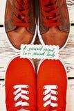 Chaussures de sport et proverbe de santé Image libre de droits