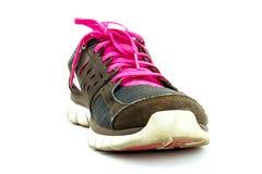 Chaussures de sport fonctionnant sur le fond blanc Photos stock