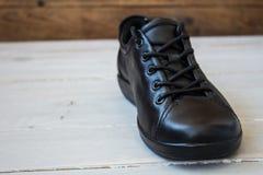 Chaussures de sport noires Photos stock