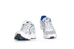 Chaussures de sport sur le blanc Photos stock