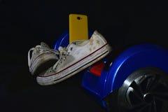 Chaussures de sport sur le patin Image stock