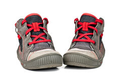 Chaussures de sports d'enfants d'isolement sur le fond blanc Photos stock