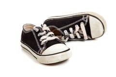 Chaussures de tennis de Childs sur le blanc Photos stock
