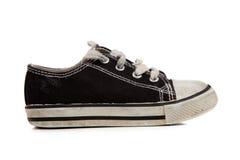 Chaussures de tennis de Childs sur le blanc Image stock