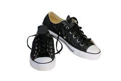 Chaussures de toile noires avec le fond blanc Image stock