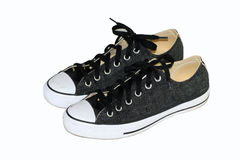 Chaussures de toile noires avec le fond blanc Photo libre de droits