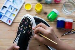 Chaussures de toile peintes Images stock