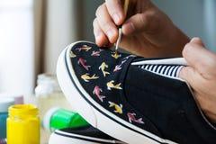 Chaussures de toile peintes Images libres de droits
