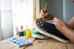 Chaussures de toile peintes Image libre de droits