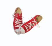 Chaussures de toile rouges avec le fond blanc Photos libres de droits