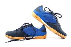 Chaussures des sports des hommes Espadrilles sur un fond blanc Photo libre de droits
