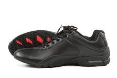 Chaussures des sports des hommes Espadrilles sur un fond blanc Photographie stock libre de droits