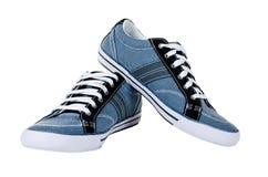 Chaussures en caoutchouc bleus modernes d'isolement sur le blanc Photo stock