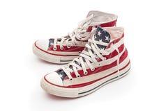 Chaussures en caoutchouc d'isolement sur le blanc Images libres de droits