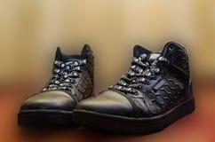 Chaussures en caoutchouc femelles d'isolement sur le blanc Photos stock