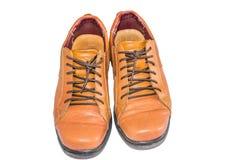 Chaussures en cuir de Brown avec le fond blanc photo stock