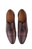 Chaussures en cuir de Brown sur le fond blanc Photos libres de droits