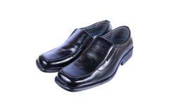 chaussures en cuir noires de luxe de messieurs d'isolement sur le blanc Photographie stock