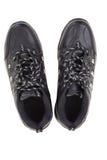 Chaussures en cuir noires sur un fond blanc Images stock