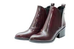 Chaussures en cuir sur le fond blanc Image stock