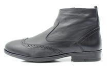Chaussures en cuir sur le fond blanc Photographie stock libre de droits