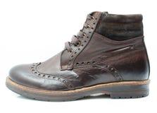 Chaussures en cuir sur le fond blanc Photographie stock