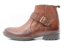 Chaussures en cuir sur le fond blanc Photo libre de droits